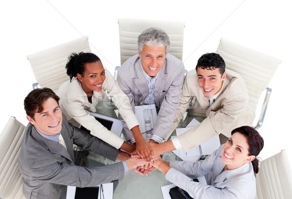 Derűs több nemzetiségű üzleti csapat kezek együtt megbeszélés Stock fotó © wavebreak_media