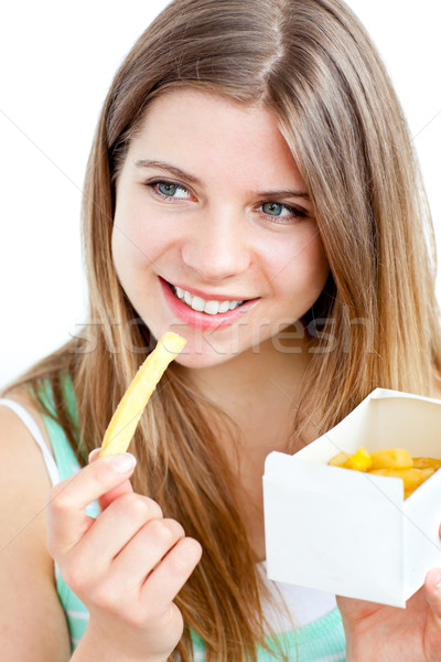 Radiant young woman eating fries against white background Stock photo © wavebreak_media