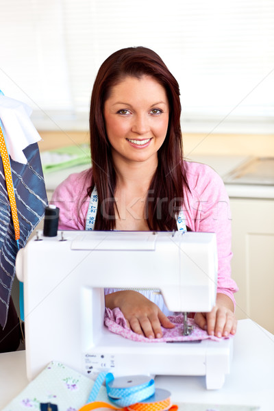 Young caucasian woman using a sewing-machine in the kitchen at home Stock photo © wavebreak_media