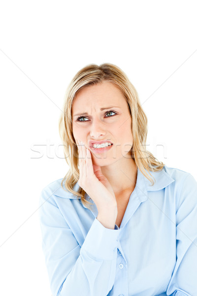 Dejected businesswoman with toothache against a white background Stock photo © wavebreak_media