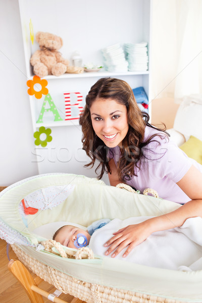 Attentive young mother taking care of her adorable baby at home Stock photo © wavebreak_media