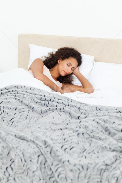 Beautiful woman sleeping peacefully on her bed in the morning Stock photo © wavebreak_media