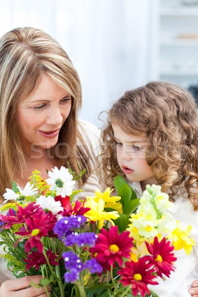 Büyükanne küçük kız çiçekler kız yüz Stok fotoğraf © wavebreak_media
