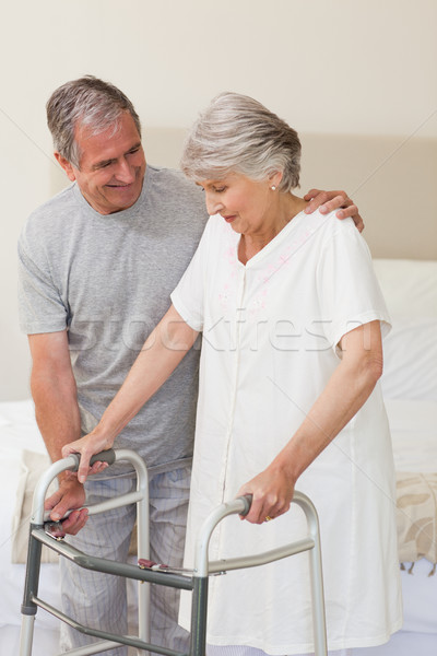 Człowiek pomoc żona chodzić szczęśliwy bed Zdjęcia stock © wavebreak_media