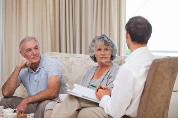 Seniors with assurance man at home Stock photo © wavebreak_media