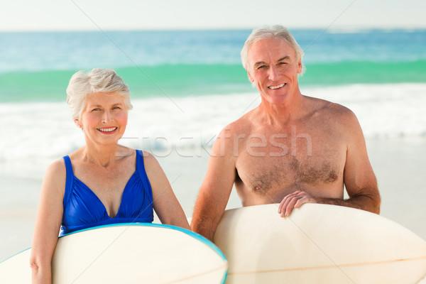 Pár szörfdeszka tengerpart mosoly nők boldog Stock fotó © wavebreak_media