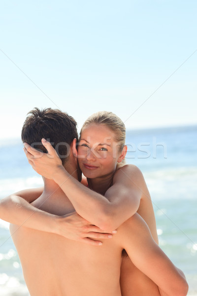 Enamored couple at the beach Stock photo © wavebreak_media