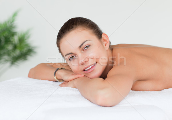Smiling brunette looking at the camera in a spa Stock photo © wavebreak_media