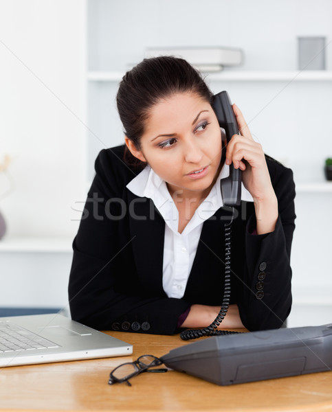A cute businesswoman is telephoning in her office Stock photo © wavebreak_media