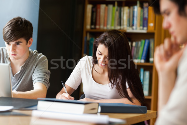 Students working on an essay in the library Stock photo © wavebreak_media