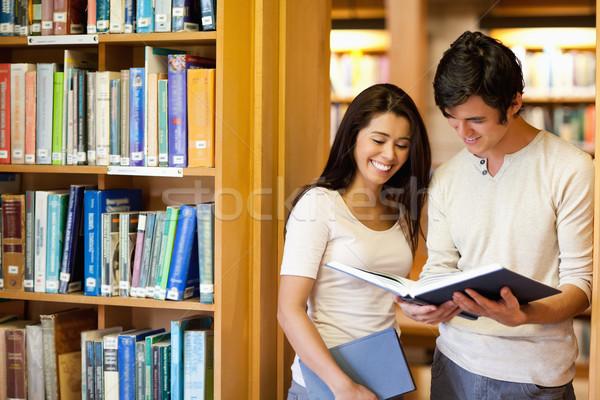 Öğrenciler bakıyor kitap kütüphane kitaplar öğrenci Stok fotoğraf © wavebreak_media