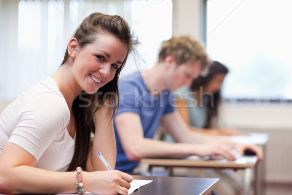 笑顔の女性 書く 教室 女性 幸せ 教育 ストックフォト © wavebreak_media