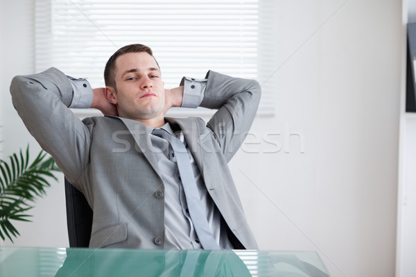 Young businessman taking a small break sitting behind a table Stock photo © wavebreak_media