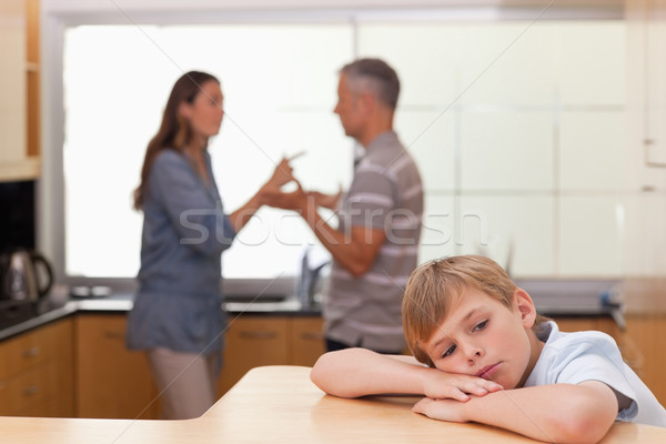 Sad little boy hearing his parents arguing in a kitchen Stock photo © wavebreak_media