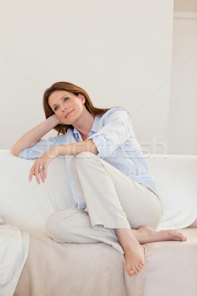 Donna pensieri divano felice home lounge Foto d'archivio © wavebreak_media