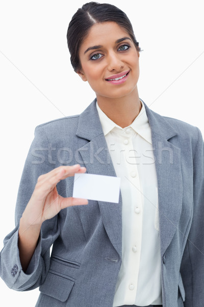 Smiling saleswoman showing her blank business card against a white background Stock photo © wavebreak_media
