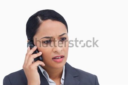 Közelkép negatív meglepődött elarusítónő mobiltelefon fehér Stock fotó © wavebreak_media