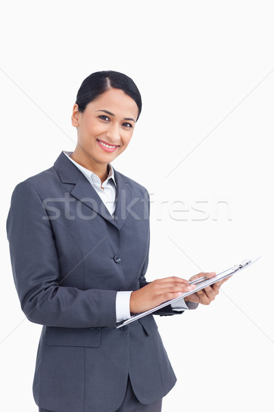 Stock photo: Close up of saleswoman with pen and clipboard against a white background