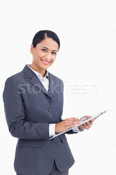 Közelkép elarusítónő toll vágólap fehér állás Stock fotó © wavebreak_media