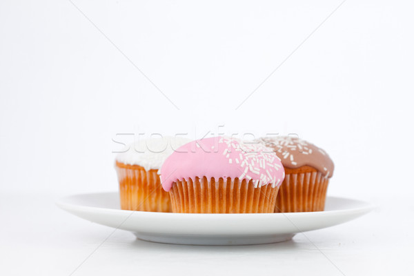 Muffins with icing sugar on a white plate against a white background Stock photo © wavebreak_media