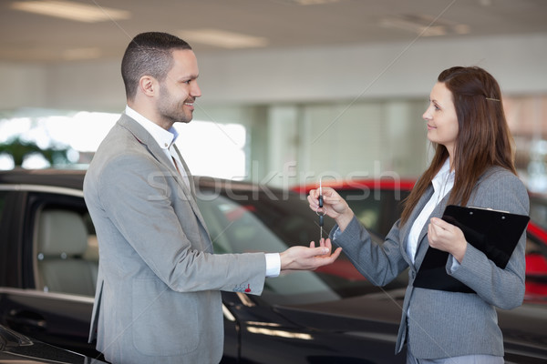 Woman giving car keys to a client in a dealership Stock photo © wavebreak_media