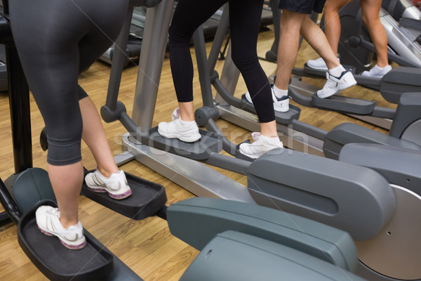 Four people stepping on step machine in gym  Stock photo © wavebreak_media