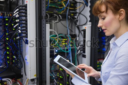 Woman using tablet pc in front of servers in data center Stock photo © wavebreak_media