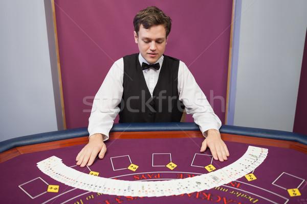 Concessionario fuori deck carte casino sorridere Foto d'archivio © wavebreak_media