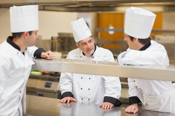 Három séfek megbeszél konyha boldog háttér Stock fotó © wavebreak_media