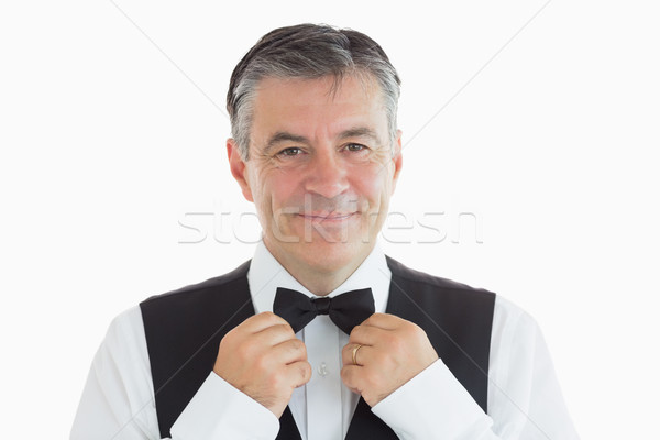 Happy waiter adjusting his bow tie Stock photo © wavebreak_media