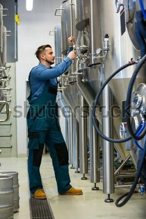 Man standing next to a server tower Stock photo © wavebreak_media