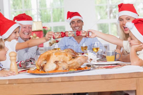 Siblings pulling a christmas cracker Stock photo © wavebreak_media