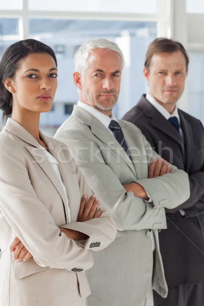 Três sério pessoas de negócios em pé juntos Foto stock © wavebreak_media