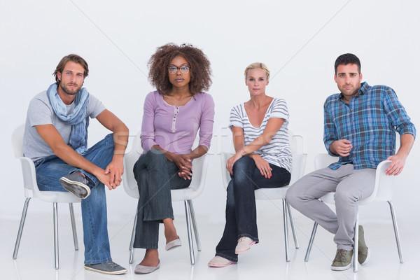 Stylish people sitting and looking at camera Stock photo © wavebreak_media