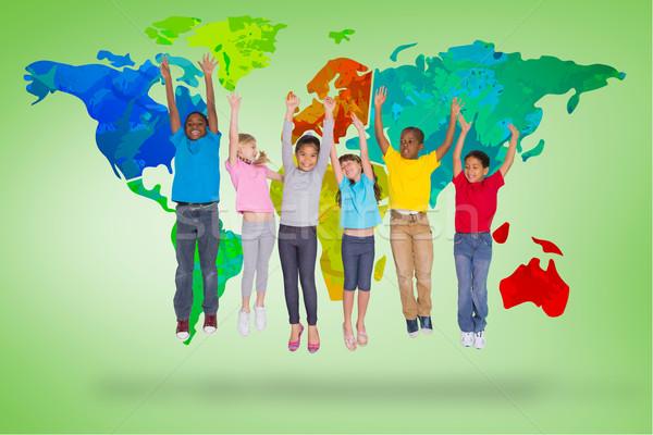 Imagem elementar alunos saltando verde Foto stock © wavebreak_media