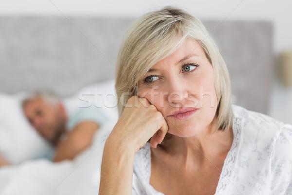 Donna matura seduta letto uomo primo piano home Foto d'archivio © wavebreak_media