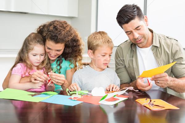 Boldog család művészetek iparművészet együtt asztal otthon Stock fotó © wavebreak_media
