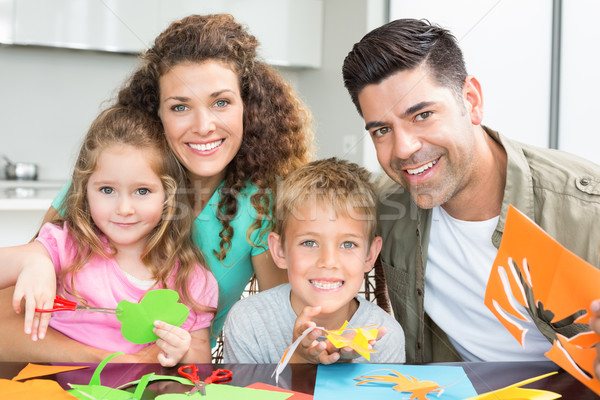 Happy young family doing arts and crafts at the table Stock photo © wavebreak_media