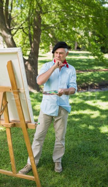 Teljes alakos érett férfi festmény park vászon boldog Stock fotó © wavebreak_media