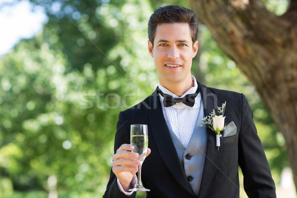 Groom holding champagne flute in garden Stock photo © wavebreak_media