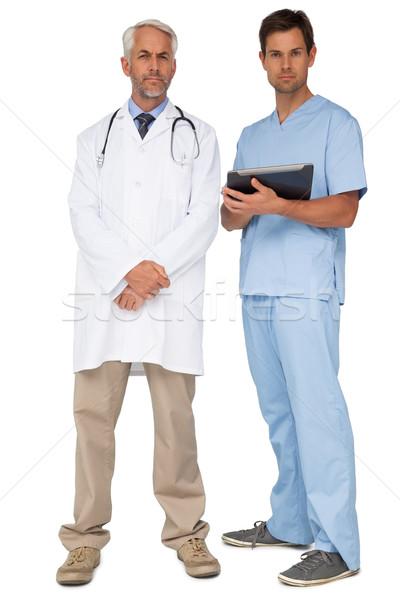 Portrait médecin de sexe masculin chirurgien numérique comprimé blanche Photo stock © wavebreak_media