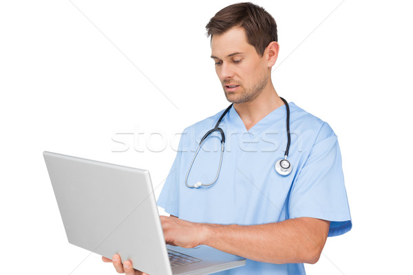 Concentrated male surgeon using laptop Stock photo © wavebreak_media