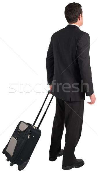 Fiatal üzletember húz bőrönd fehér férfi Stock fotó © wavebreak_media