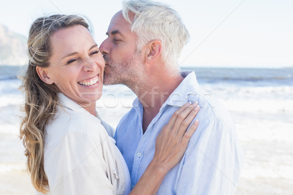 Man kissing his smiling partner on the cheek at the beach Stock photo © wavebreak_media
