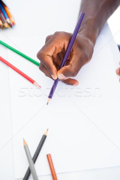 Man colouring with purple pencil Stock photo © wavebreak_media