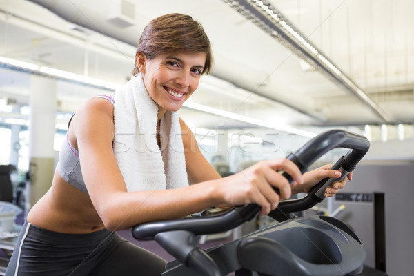 Fit smiling brunette working out on the exercise bike Stock photo © wavebreak_media