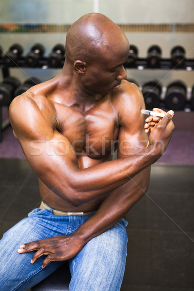 Muscular man injecting steroids Stock photo © wavebreak_media
