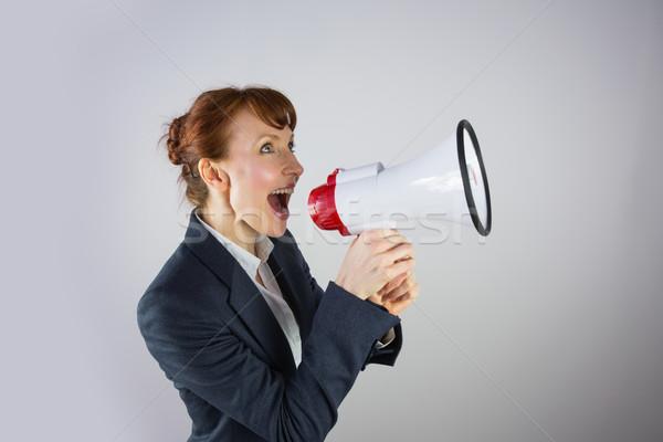 Sorridente empresária megafone cinza negócio Foto stock © wavebreak_media