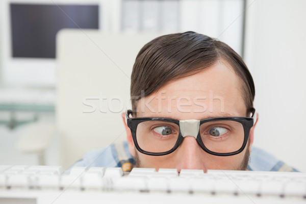 Nerdy businessman working on computer Stock photo © wavebreak_media