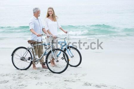 Happy senior couple looking out to the sea Stock photo © wavebreak_media